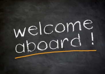 Chalkboard sign saying welcome aboard