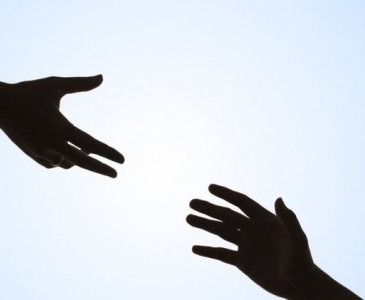 two hands outstretched from opposite ends