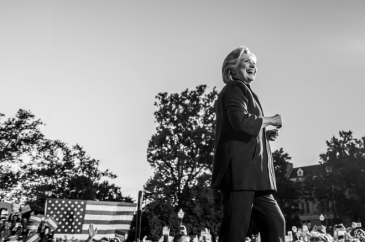Hillary Clinton smiling in front of a crowd of supporters