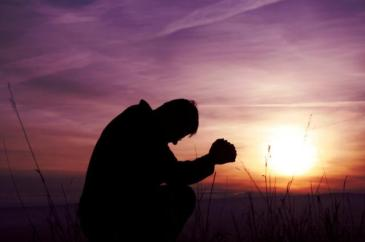 Man kneeling and praying