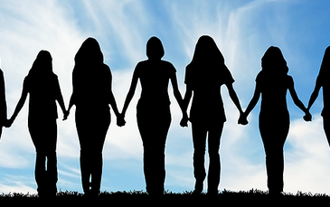 group of women holding hands