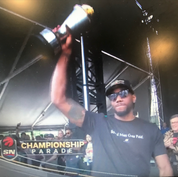 Person holding trophy in the air.