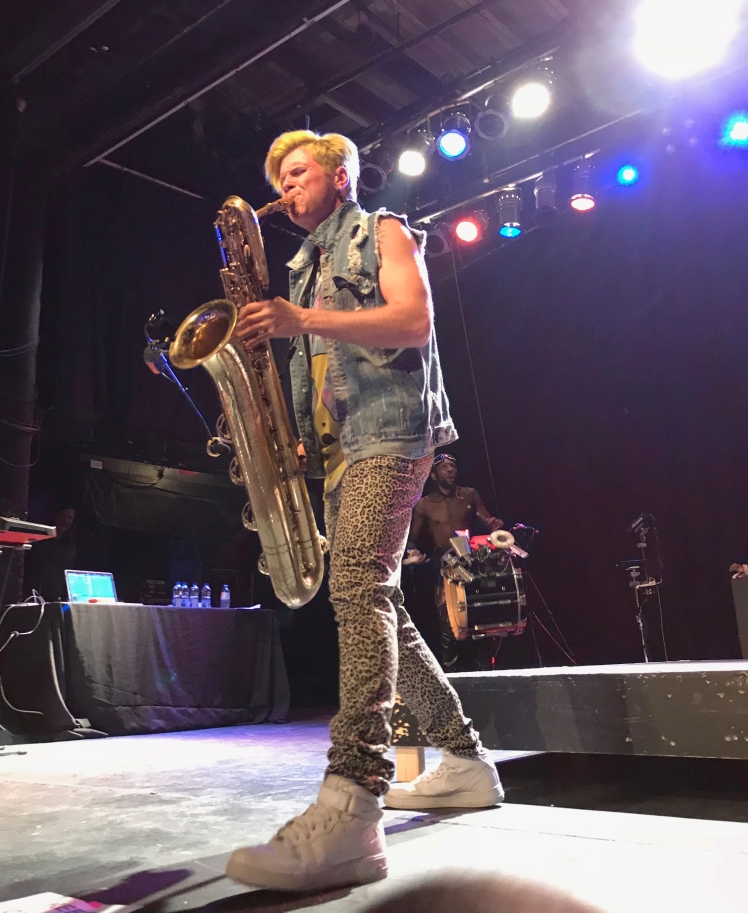 Musician playing the saxophone onstage