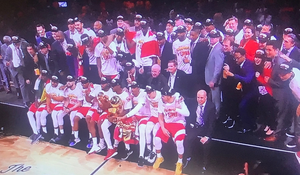 Toronto Raptors pose for a group shot after celebrating their win.