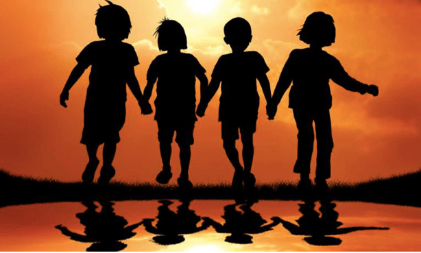 Four friends holding hands