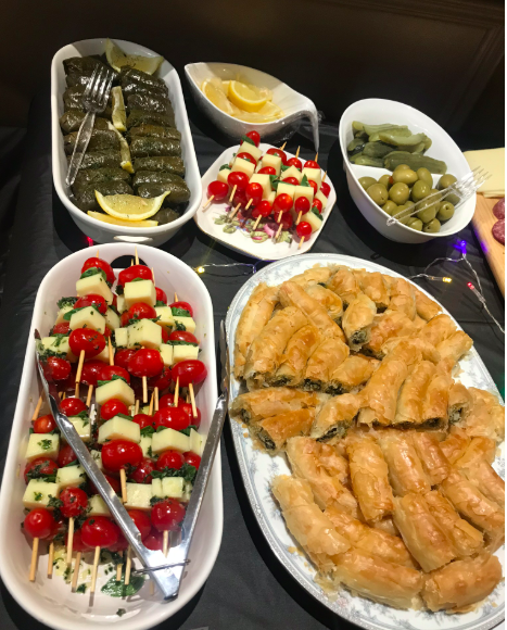 A display of various finger foods and appetizers.